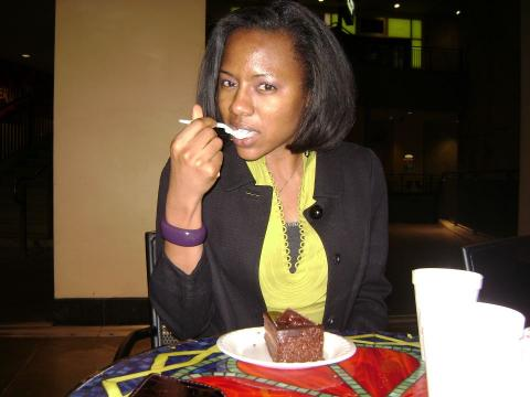 Jemila eating a Vegan Chocolate Cake